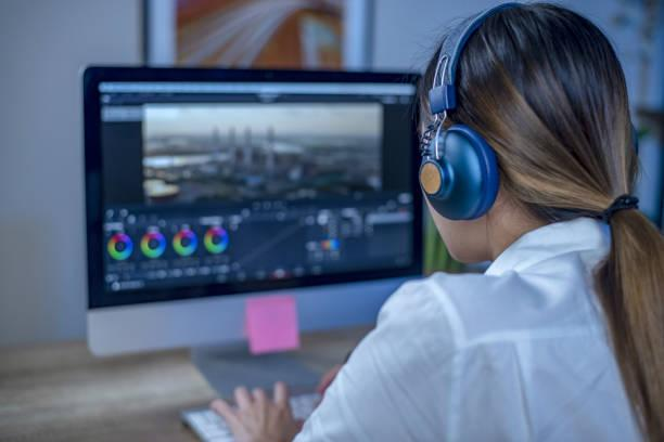Working woman video editing in the studio