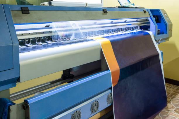 Large inkjet printer head working on blue vinyl banner